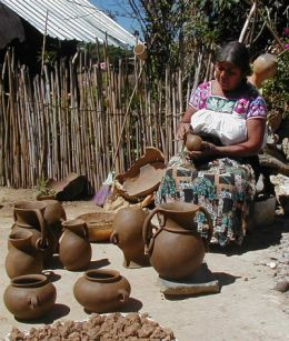 Woman making ollas