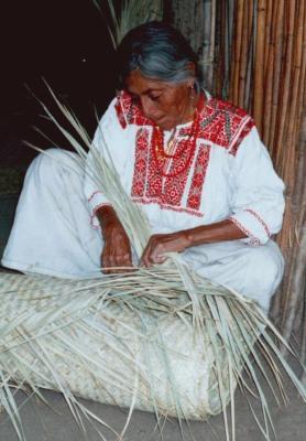 Woman weaving a petate