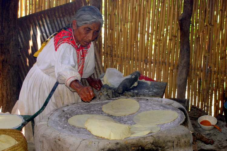 Woman cooking tortillas