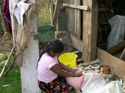 Zapotec woman shelling corn
